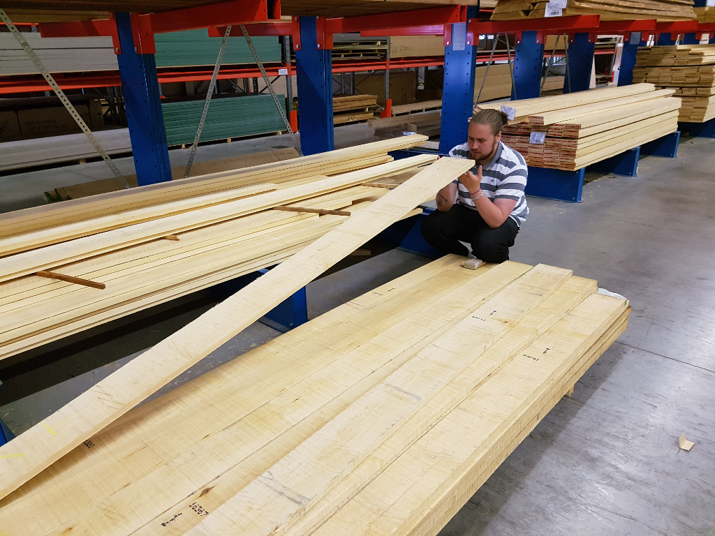 Johan inspecting maple planks